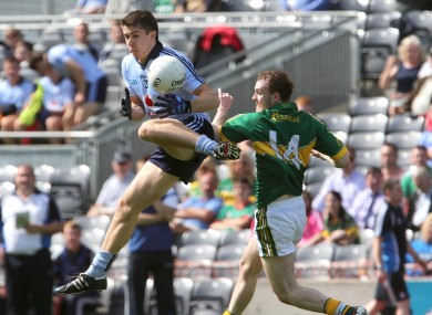 David Byrne beats Kerry's Niall Sheehy to the ball.