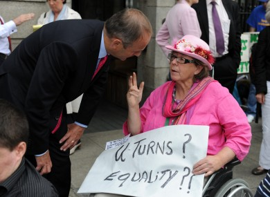 Dr Margaret Kennedy speaking to Fianna Fáil leader Micheál Martin at her protest outside Leinster House - one of her comments features in our pick of the week.