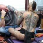 Tattoo artist Durga works at the Eighth London International Tattoo Convention in Wapping, east London.