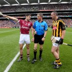 Galway's Fergal Moore and Eoin Larkin of Kilkenny with referee Barry Kelly at the coin toss.