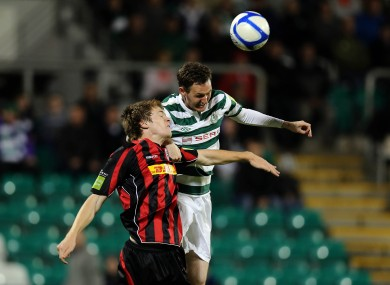 Rovers striker Gary Twigg rises higher than Bohs' Kevin Feely.