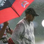 2006: Tiger Woods stands in the rain on the 18th green after losing a foursome match against Luke Donald and Sergio Garcia.