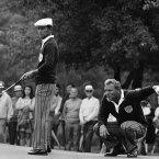 1971: Arnold Palmer, right, helps teammate Gardner Dickinson line up a putt.
