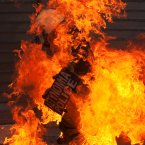 Riot policemen on fire after a petrol bomb thrown by protesters. (AP Photo/Petros Giannakouris)