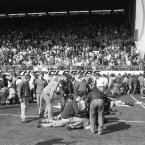 Fans receive attention on the pitch. (Photo: David and John Giles/PA Wire)
