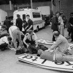 Injured fans on advertising boards wait to be taken to hospital. (Photo: PA Wire)