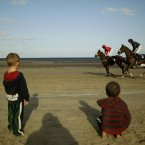 Young racing fans watch the action at Laytown Racecourse, Dundalk.