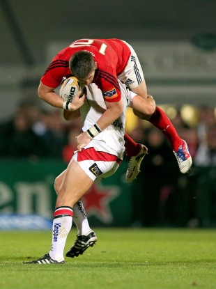 Michael Allen of Ulster takes Munster's James Downey for a ride.