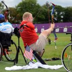 USA's Matt Stutzman holds the bow with his foot as he competes during the Men's Archery Individual Compound Open ranking round at Woolwich Arsenal, London.