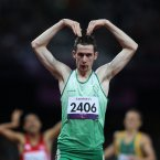 Ireland's Michael McKillop does the 'MoBot' after winning Gold in the Men's 800m - T37 Final in a new world record time at the Olympic Stadium, London.