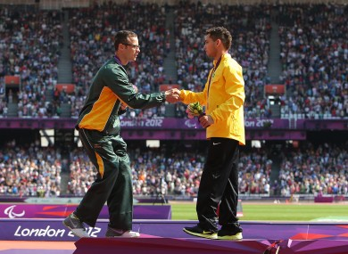 Oscar Pistorius shakes hands with 200m gold medalist Alan Oliveira.