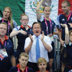 Prime Minister David Cameron and Team GB athletes watch Great Britain swimmer Ellie Simmonds win a gold medal in the Women's 200m at the Aquatic Centre in the Paralympic Games in London.  PRESS ASSOCIATION Photo. Picture date: Monday September 3 2012 See PA story. Photo credit: Stefan Rousseau/PA