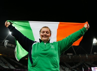 Ireland's Orla Barry celebrates her third place finish in the women's discus throw F57/58 at the Olympic Stadium.