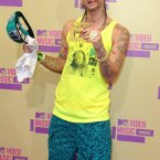 Living up to his name, Riff Raff opted for beach hobo-chic. Keep an eye out for new lines of couture hand towels, they'll be storming the catwalks this season. (Image:Doug Peters/EMPICS Entertainment)