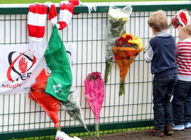 Flowers are laid by young fans at Ravenhill over the weekend.