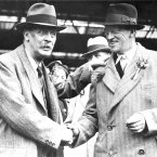 1931: Samuel Ryder, left, donor of the famous cup, shakes hands with Charles Whitcombe, the captain of the Great Britain team.