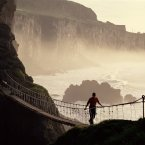 Carrick-a-Rede Rope Bridge is a rope suspension bridge near Ballintoy, Co Antrim. The bridge links the mainland to the tiny Carrick Island. Image: Chris Hill/Tourism Ireland.