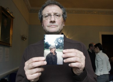 Holding an image of Sophie Toscan du Plantier is her uncle Jean-Pierre Gazeau