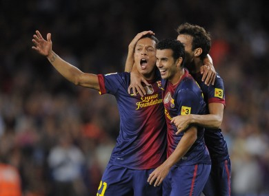 FC Barcelona's Adriano, left, reacts after scoring against Valencia during a Spanish La Liga match.