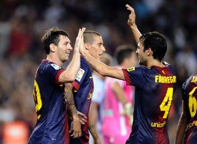 Leo Messi and Fabregas last night.