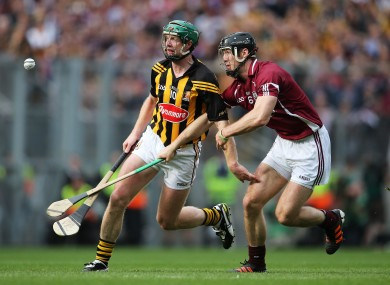 Henry Shefflin and Tony Og Regan battle for possession in the drawn final.