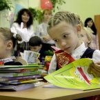 A schoolgirl looks at a book as she sits at a desk on her first day at school in Kiev, Ukraine. Ukrainian children began their new school year on Sept. 1, known as Knowledge Day. (AP Photo/Efrem Lukatsky)