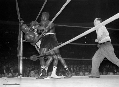 Emile Griffith, right, sends welterweight champion Benny 