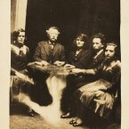Group seance with 'levitating' table