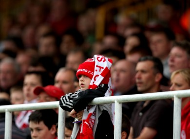 A young Sligo Rovers fan watches his team.