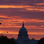 In Washington, the US Capitol dome is silhouetted as the sun rises. (AP Photo/J. Scott Applewhite)