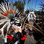 Visitors wearing traditional costumes take part in a procession marking Dia de los Muertos (Day of the Dead) at the Hollywood Forever Cemetery in the Hollywood section of Los Angeles on Saturday. (AP Photo/Richard Vogel)