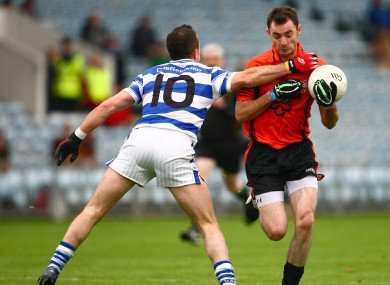 Duhallow's Donncha O'Connor is tackled by Castlehaven's Roland Whelton