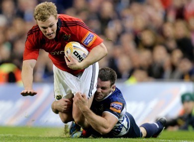 Leinster's Fergus McFadden tackles Keith Earls of Munster.