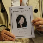 A mass card is held up by a mourner in St.Peter's Church Drogheda. Image: Julien Behal/PA Wire.