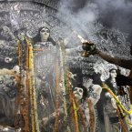 A priest worships an idol of Hindu goddess Durga during the Durga Puja festival in Kolkata, India. The five-day festival, commemorates the slaying of a demon king by lion-riding, 10-armed goddess Durga, marking the triumph of good over evil. (AP Photo/Bikas Das)