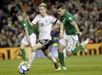 Germany's Marco Reus runs past Republic of Ireland's Seamus Coleman.