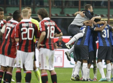 The Inter players celebrate at the final whistle.