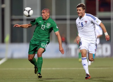 Ireland's Jonathan Walters and Rogvi Baldvinsson of Faroe Islands.