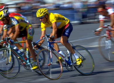 Lance Armstrong in Paris in 1999, about to claim his first Tour de France. An Irish aide states in an affidavit that she bought concealer so that Armstrong could cover a bruise on his arm, caused by a syringe, days before the race began.