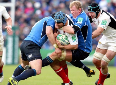 Shane Jennings and Leo Cullen double up on Schalk Brits in 2011.