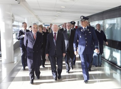 President Higgins arriving to Santiago Arturo Merino Benitez Airport with Ambassador James Sinclair Manley (left) and Brigadier General Ronaldo Mercado , General Commander of the Air Garrison yesterday morning.