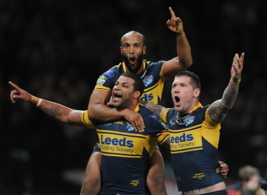 Leeds Rhinos' Ryan Bailey (left), Brett Delaney and Jamie Jones-Buchanan (top) celebrate.