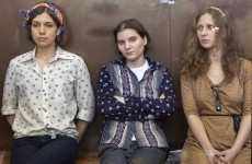 Russia frees one Pussy Riot member, keeps two in jail