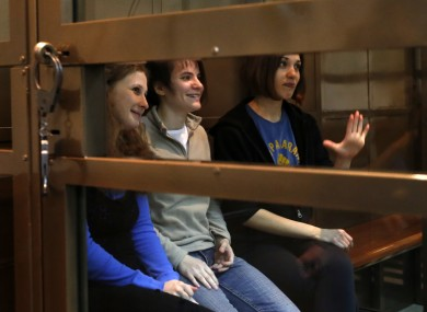 The band members sit in a glass cage at a court room in Moscow, Russia on Monday 1 Oct, 2012