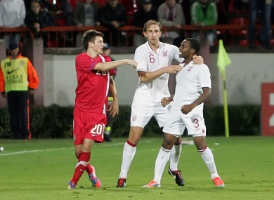 Serbian player Milos Ninkovic, left, and England's Danny Rose, right, and Craig Dawson, centre, clash during their 2013 European Under-21 Championship play-off.