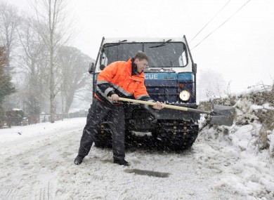 A member of the Dublin Civil Defence shovelling snow during the bigg freeze in 2010.