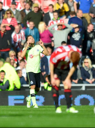 Newcastle United's Yohan Cabaye celebrates after scoring his team's opening goal against Sunderland.