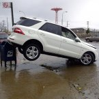 A car is upended on a mailbox on Surf Avenue in Coney Island, NY, in the aftermath of Sandy on Tuesday. (AP Photo/Ralph Russo)