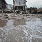 A beachfront house is damaged in the aftermath of yesterday's storm surge from Hurricane Sandy, in Coney Island's Sea Gate community in New York. 