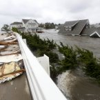 Floodwaters surround homes near the Mantoloking Bridge the morning after hybrid storm Sandy rolled through Mantoloking, NJ. S
